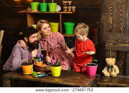Ecology Concept. Little Child Help Mother And Father Planting Flower To New Pot, Ecology. Ecology An