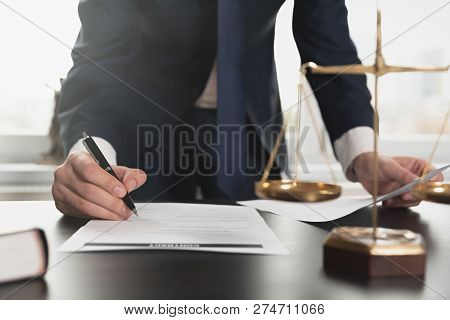 Lawyer Working With Documents. Justice Concept