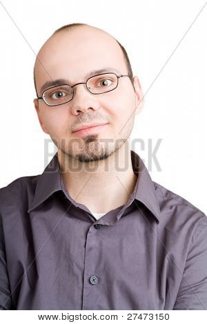 Young man looking satisfied into the camera