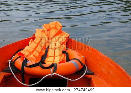 Outfit Of Lifeguard On Water In Summer Boat, Life Jacket, Lifebuoy In Orange Color. Rescue On Water