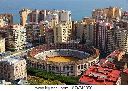 Malaga, Spain. Cityscape With Hotels And Bullring Stadium.