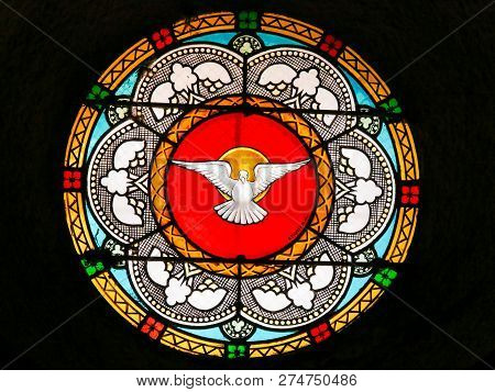 Antibes, France - November 16, 2018: Stained Glass In The Church Of Antibes, France, Depicting A Dov