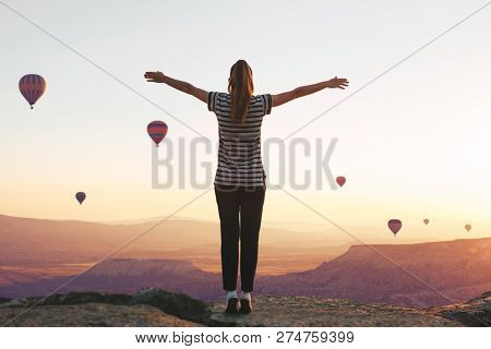 A Girl Stands On Top Of A Mountain In Solitude, Admires The Beautiful View Of The Natural Landscape