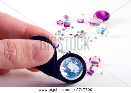 Loose Gems,Fingers And Loupe