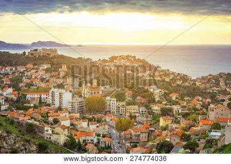 Aerial View At Dawn On The Marseille City And Its Harbor, France