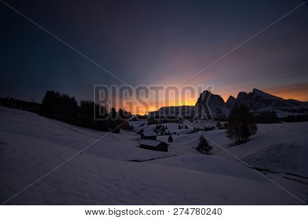Colorful sunrise in Dolomite mountains in Alpe di Siusil, Italy in winter.