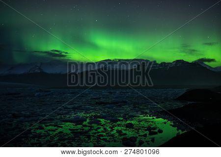Aurora Boreal Over Jokulsarlon Lagoon In Iceland