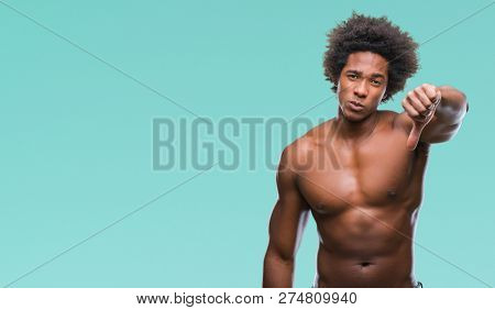 Afro american shirtless man showing nude body over isolated background looking unhappy and angry showing rejection and negative with thumbs down gesture. Bad expression.