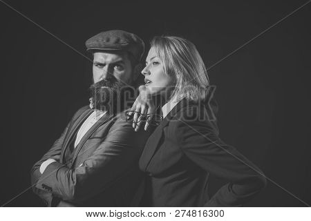 Man And Woman In Retro Suit And Hat On Dark Background. Private Investigator Concept. Couple Of Dete