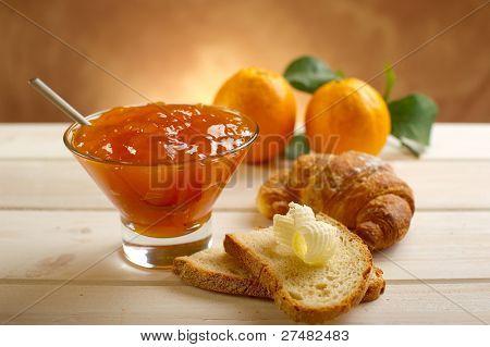 orange jam with toast and croissant
