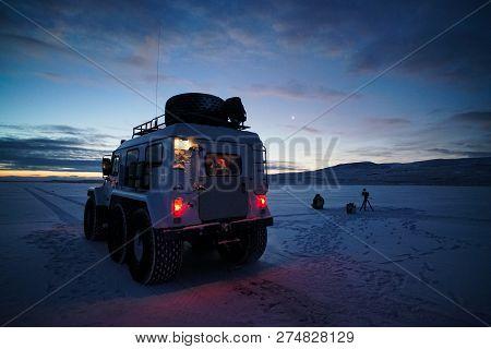 All-terrain Vehicle On Background Of Sunrise, Winter Season.