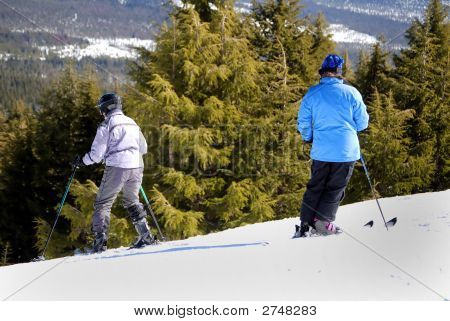 Skiers Starting Down A Slope
