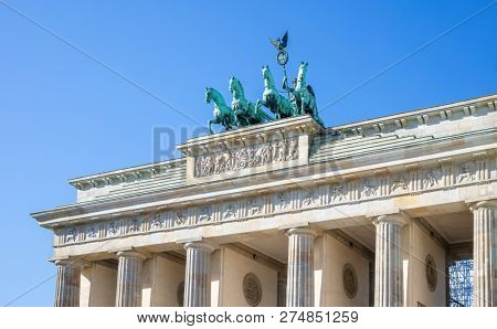 Brandenburg Gate In Berlin. Famous destination in Germany. Clear blue sky background.