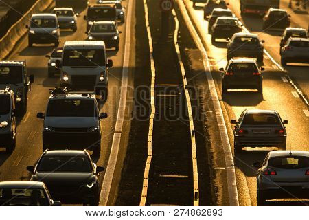 Heavy morning city traffic/congestion concept - cars going very slowly in a traffic jam during the morning rushhour poster