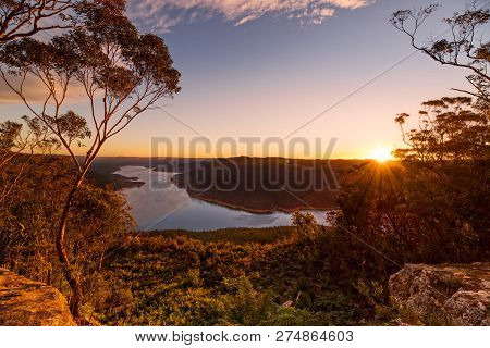 Sunset Scenic Vista From Nattai With Burragorang Lake In View.  Rocky Escarpment With Large Gum Tree