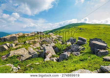 Grassy Slope With Huge Rocks. Wonderful Summer Landscape In Mountains. Grassy Meadow With Huge Bould