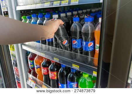 Bangkok, Thailand - December 19, 2018: Unidentified Customer Takes A Bottle Of Pepsi Max From The Re