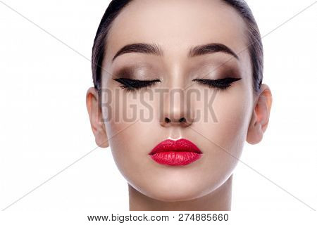 beauty portrait of attractive young caucasian woman brunette isolated on white studio shot red lips face head eyes closed skin makeup eyes