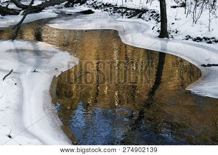 Winter Idyll With A Small Brook In The Taunus, Hesse, Germany.