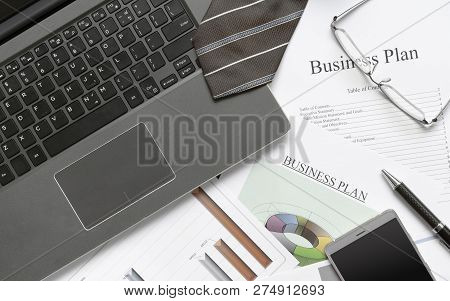 Writing Business Plan Preparation Concept. Business Still-life With Computer Notebook, Business Plan