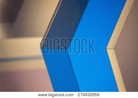 The White Blue Geometric Background. A Lot Of Angles Lines And A Few Shades Of Color, Arrow Directio