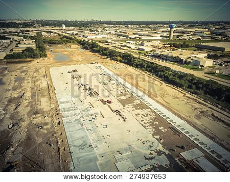Top View Footing And Foundation Of Construction Site With Warehouse In Background