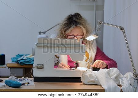 image of female tailor at work in the atelier poster