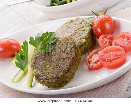 vegetarian spinach croquettes with tomatoes