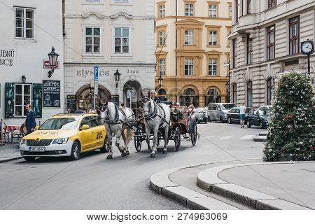 Prague, Czech Republic - August 28, 2018: Horse And Carriage Tour On A Street In Prague. Carriage To
