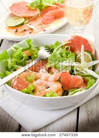 shrimp salad with slice grapefruit and lettuce
