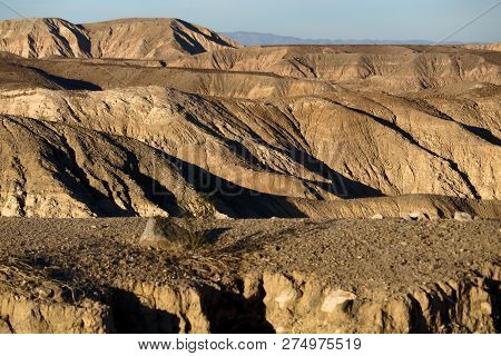 Arid Landscape including canyons with erosion creating natural shadows on rural badlands taken at the Colorado Desert in Anza Borrego State Park, CA poster