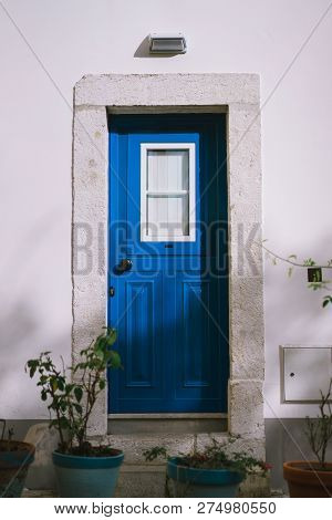 Small Traditional Blue Door Of The House In Lissabon, Lisboa Portugal