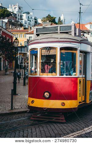 Vintage Red Tram In The City Center Of Lisbon. City Touristic Landmarks Of Lisboa Lissabon