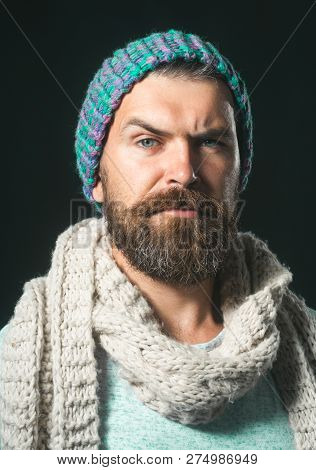 Handsome Stylish Man In Elegant Autumn Clothing. Bearded Man In Blue Pullover, Hat, Scarf. Men's Fas
