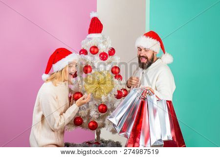 Shopping In Christmas Time. Discount, Sale, Gifts, Holidays, Christmas, Family Concept - Happy Coupl