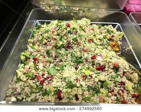 Turkish Bulgur Salad With Pomegranate Seeds At Salad Bar / Organic Bulghur Tabbouleh Food. Tradition