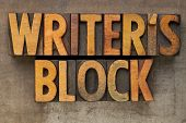 writer block - text in vintage wood letterpress printing blocks stained by color inks on a grunge metal tray poster