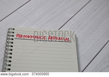 Performance Appraisal Write On A Book Isolated Wooden Table.