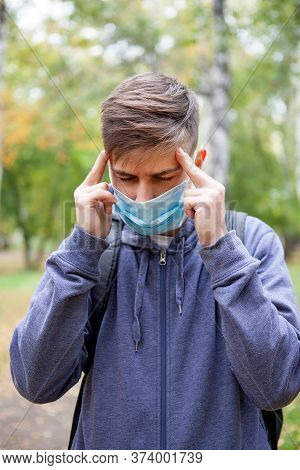 Sick Young Man In The Flu Mask In The Autumn Park