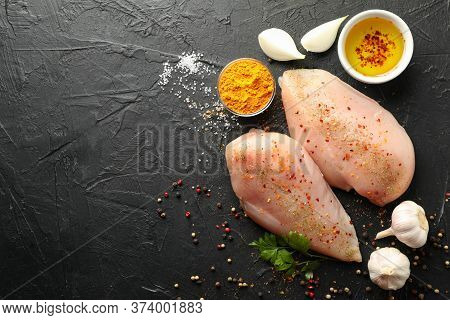 Raw Chicken Meat And Spices On Black Background, Top View. Cooking Chicken
