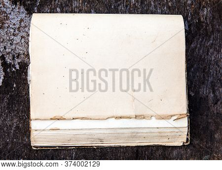 Old Book With Blank Cover On The Wooden Background Closeup