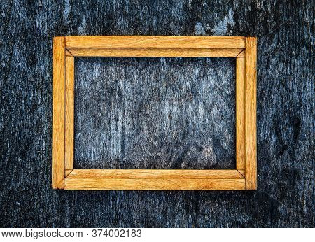 Old Wooden Frame On The Grunge Background Closeup