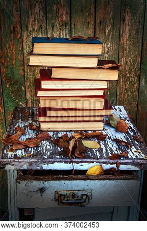 Toned Photo Of Pile Of Books On The Old Table Outdoor