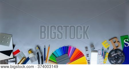 Advertising Mattrials And Samples On Silver Background. Colour Palette, Plastic And Metal Samples, T