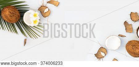 Summer Flat Lay Scene With Palm Leaves And Frangipani Flowers With Coconuts On Wooden Background Wit