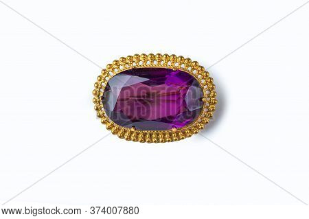 Vintage Antique Brooch With A Large Semi-precious Purple Stone On White Background. Oldfashioned Dec