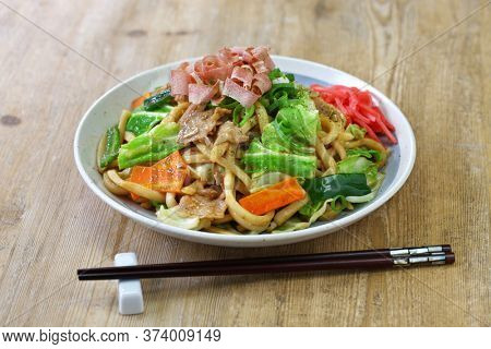 yaki udon , a kind of  japanese udon noodle dish, pan fried udon noodles with meat and vegetables