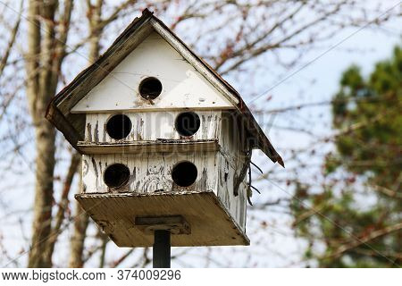 An Old White Multiple Hole Rural Country Birdhouse
