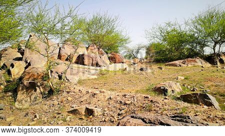 Large Rocks On Plateau With Thorny Bushes On A Mountain Or Hill