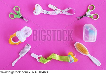 Flat Lay On Baby Care Items - Scissors, Hairbrushes, Pacifiers, Pacifier Holders, Nasal Aspirator An